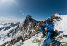 Bergsteiger am Gipfel des Piz Bianco